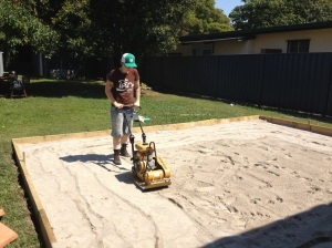 outdoor paved area - level sand with a compacter