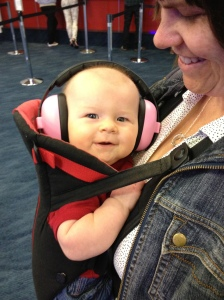 Quin rocking her pink baby earmuffs