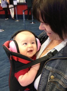 Quin showing her mummy her pink baby ear muffs